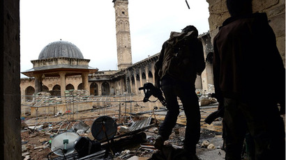 A picture taken on April 16, 2013 shows Syrian rebel fighters in Aleppo's Umayyad Mosque complex. (AFP Photo / Dimitar Dilkoff)