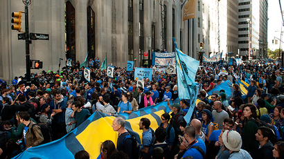 Demonstrators unfurl a banner on Broadway during the Flood Wall Street protest on September 22, 2014 in New York City. (Bryan Thomas / Getty Images / AFP)
