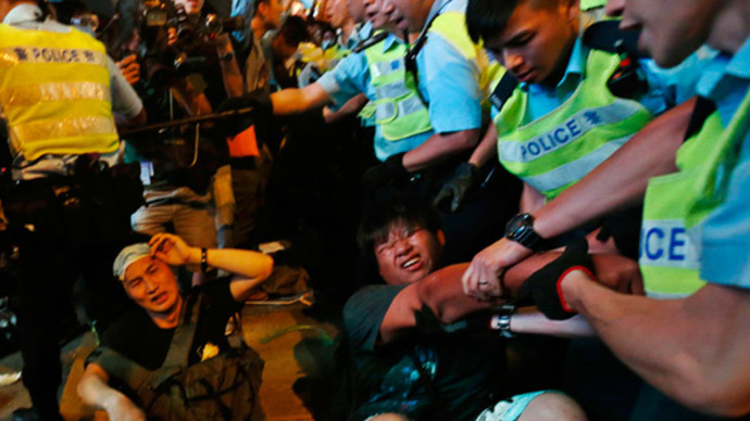 Violence, arrests in Hong Kong as protesters reoccupy camp