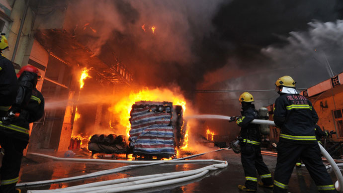 This file photo taken on January 1, 2013 shows a fire at a factory that contains six tanks of hazardous chemicals in Wenzhou, in eastern China's Zhejiang province. (AFP Photo)