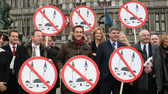 Members of several European right wing parties pose with signs, after the presentation of their organisation of 'Cities against Islamisation' in Antwerp. (AFP Photo / Jorge Dirkx)
