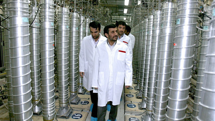 A handout picture released by the official website of Iran's presidency office shows Iranian President Mahmoud Ahmadinejad visits Natanz uranium enrichment facilities some 300 kms, south of the capital Tehran on April 8, 2008.  (AFP Photo)