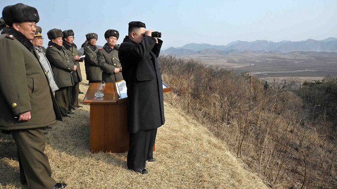 This undated photo released by North Korea's official Korean Central News Agency on February 26, 2013 shows North Korean leader Kim Jong-Un  inspecting an artillery firing drill of the Korean People's Army. (AFP Photo / KNS)