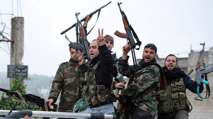Rebel fighters flash the V-sign for victory as they celebrate after taking over the village of Aljanodiya, northwestern Idlib province, following fighting against pro-Syrian regime forces, on January 30, 2013. (AFP Photo / Aamir Qureshi)