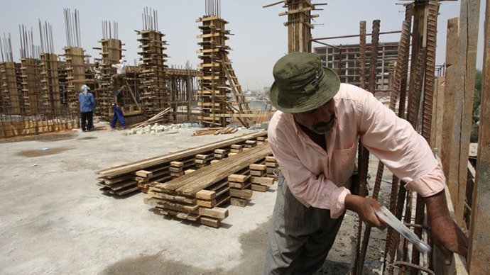 Iraqis work at a new construction site in Baghdad. (AFP Photo / Ali Al-Saadi)