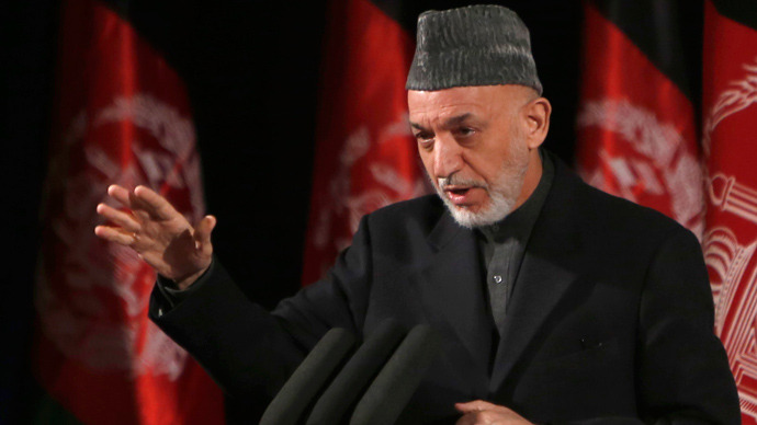 Afghan President Hamid Karzai gives a speech during an event to mark International Women's Day in Kabul March 10, 2013  (Reuters / Mohammad Ismail)