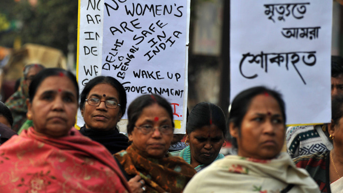 Indian protesters shout slogans as they take part in a protest rally in Siliguri on December 29, 2012, after the death of a gangrape victim from the Indian capital New Delhi. AFP Photo / Diptendu Dutta