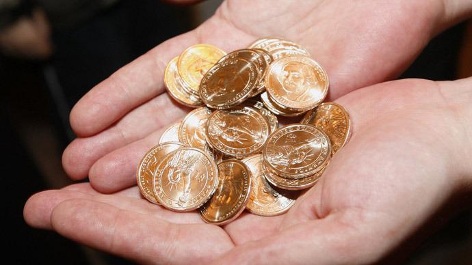 $1 coins (Reuters/Brendan McDermid)