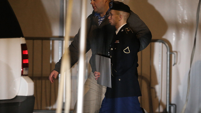 Pfc. Bradley E. Manning is escorted from a hearing  in Fort Meade, Maryland (AFP Photo /  Mark Wilson)