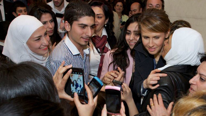 Asma al-Assad, the wife of the president of Syria, Bashar, greeted by mainly young people during an event  dubbed 'Mothers Rally' at the Opera House in Damascus. (AFP Photo / HO / Syrian Presidency Media Office)