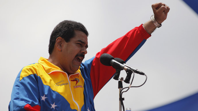 Venezuela's acting President Nicolas Maduro gestures to supporters after he registered as a candidate for president in the April 14 election outside the national election board in Caracas March 11, 2013. (Reuters/Marco Bello)