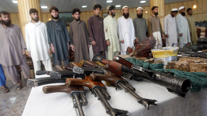 Taliban insurgents and their weapons confiscated by Afghan joint forces during an operation are presented to the media in Jalalabad province (Reuters/Parwiz)