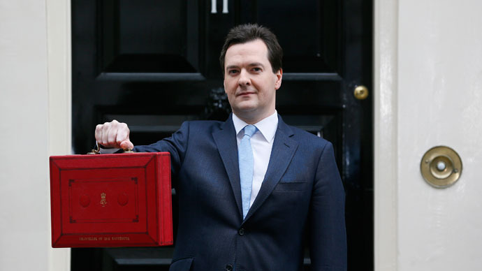 Britain's Chancellor of the Exchequer, George Osborne, holds up his budget case for the cameras as he stands outside number 11 Downing Street, before delivering his budget to the House of Commons, in central London March 20, 2013.(Reuters / Stefan Wermuth)