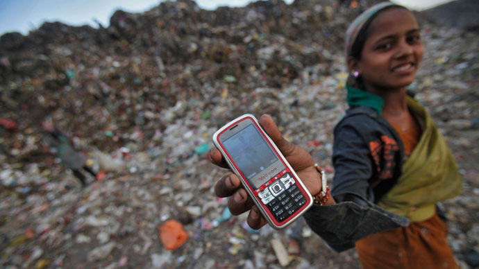 A ragpicker holds her mobile phone to show a picture she took at a dump yard on World Environment Day in New Delhi.(Reuters / Adnan Abidi)