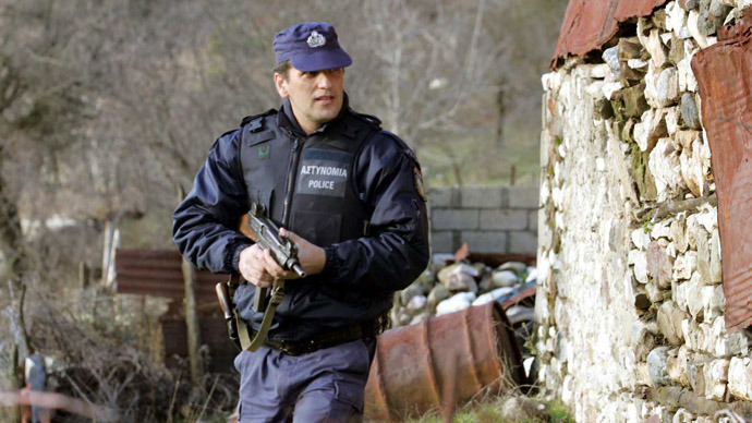 Greece, Trikala: Greek police and army units mount a manhunt in mountainous northwestern Greece for two convicts who escaped a police van earlier in the day, killing two officers in the process on 30 December 2005 (AFP Photo)