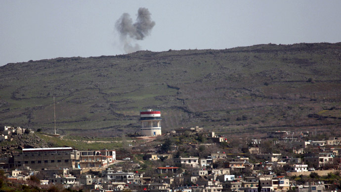 A picture taken from the Israeli side of the occupied Golan Heights shows smoke after shells allegedly exploded in the Syrian village of Hadar, close to the ceasefire line between Israel and Syria on March 20 , 2013. (AFP Photo/Jalaa Marey)
