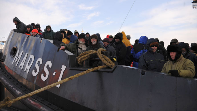 Fishermen are pictured on a rescue ship at the Riga Port Authority on March 29, 2013 in Riga.(AFP Photo / Edijs Palens)