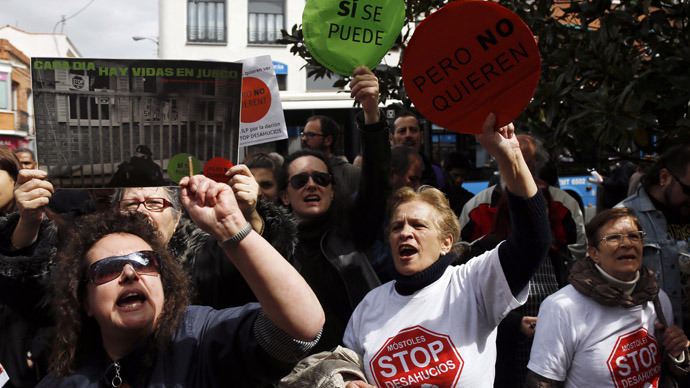 Members of the Platform for Mortgage Victims (PAH) shout slogans during a protest in Madrid April 3, 2013. (Reuters)