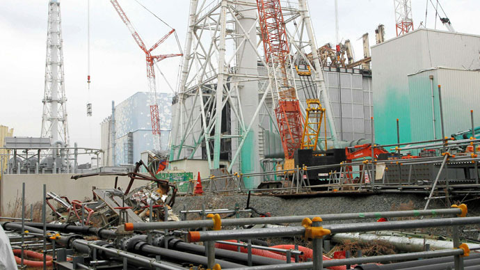 A general view shows unit three and unit two reactor building (light blue, L) of the Tokyo Electric Power Co (TEPCO) Fukushima Dai-Ichi nuclear power plant stands in Okuma Town, in Fukushima prefecture on March 1, 2013.(AFP Photo / Japan Pool via Jiji Press)