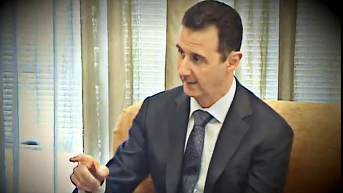 Syrian President Bashar al-Assad gesturing during an interview with Turkish television Ulusal and Aydinlik newspaper in Damascus on April 2, 2013. (AFP Photo / Presidency Media Office)