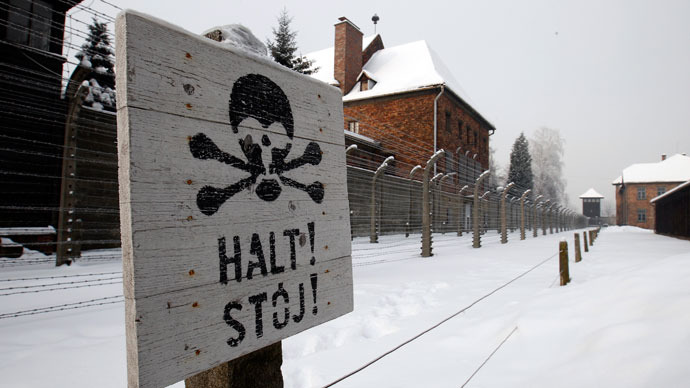 "A sign that reads ""Stop"" placed near a barb wire is seen at the concentration camp during a ceremony marking the 68th anniversary of the liberation of the Auschwitz by Soviet troops and to remember the victims of the Holocaust, in Auschwitz Birkenau.(Reuters / Peter Andrews)"