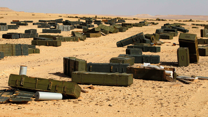 Crates containing shells and hand rockets are seen in a desert some 130 km (81 miles) south of Sirte October 30, 2011 (Reuters / Youssef Boudlal)