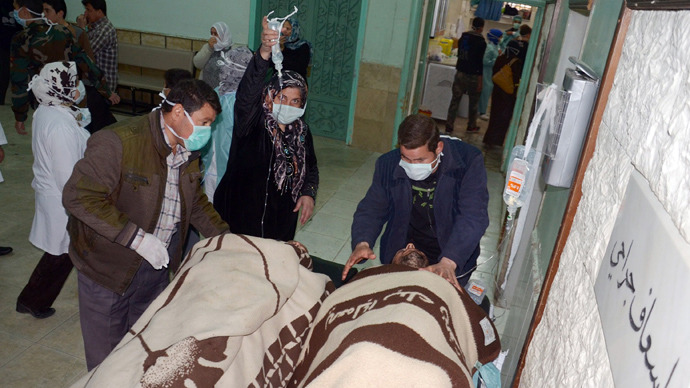 People are brought into a hospital in the Khan al-Assal region in the northern Aleppo province, as Syria's government accused rebel forces of using chemical weapons for the first time on March 19, 2013 (AFP Photo / Sana)
