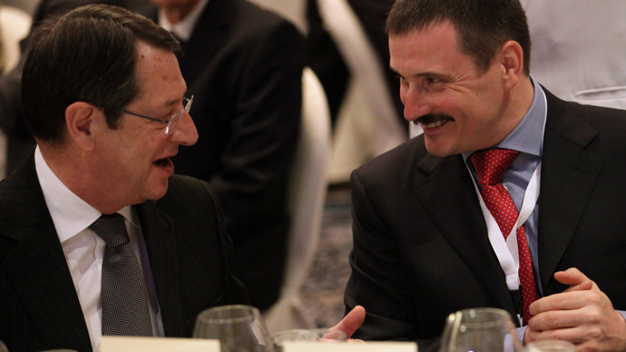 Cypriot President Nicos Anastasiades (L) chats with Chairman of the Bank of Moscow, Russian Mikhail K. Kuzovlev during the 2013 Global Russia Business Meeting in the coastal city of Limassol on April 14, 2013 (AFP Photo / Patrick Baz)