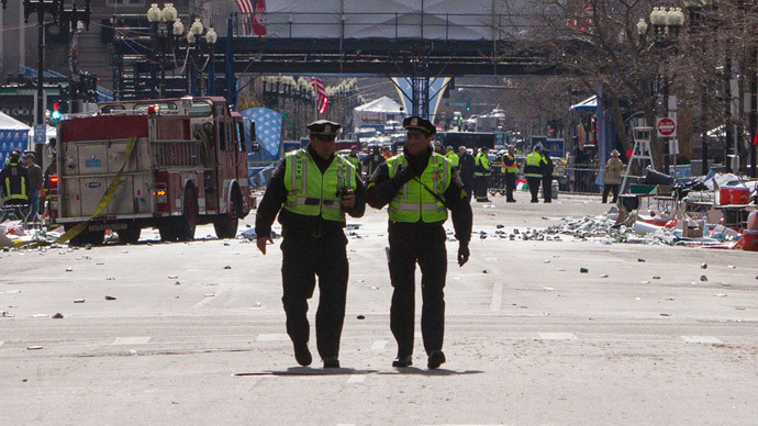 Boston police officers patrol down Boylston Street near the scene of multiple explosions near the end of the Boston Marathon finish line in Boston, Massachusetts April 15, 2013 (Reuters / Scott Eisen)