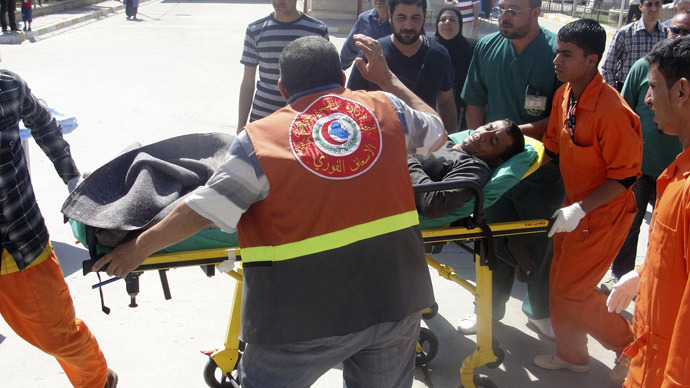 A man is brought to a hospital on a stretcher after after being wounded in a clash between Iraqi forces and Sunni Muslim protesters in Kirkuk, 250 km (155 miles) north of Baghdad April 23, 2013. (Reuters/Ako Rasheed)