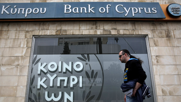 A man walks past a branch of Bank of Cyprus in Nicosia March 31, 2013. (Reuters/Yorgos Karahalis)