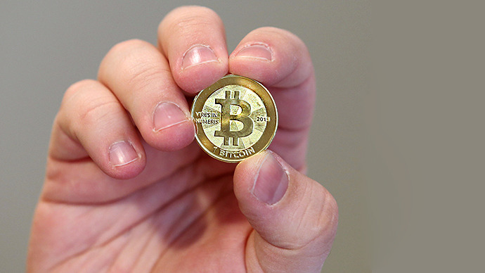 The front of a physical Bitcoin. (AFP Photo / George Frey)