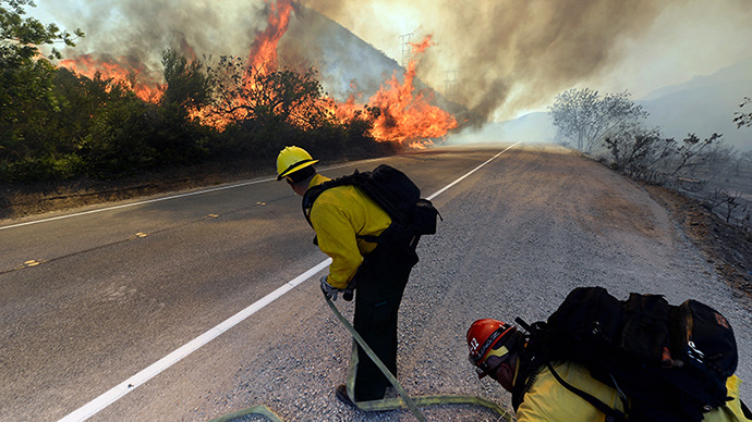 US Forestry fire fighters preapre to take on an out of control wildfire on May 2, 2013 in Camarillo, California. (AFP Photo / Getty Images / Kevork Djansezian)