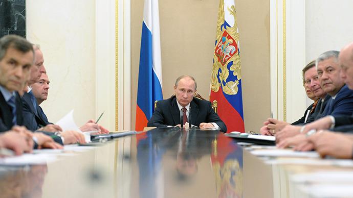 President Vladimir Putin, center, chairs a Security Council meeting on May 8, 2013. (RIA Novosti / Alexei Druzhinin)