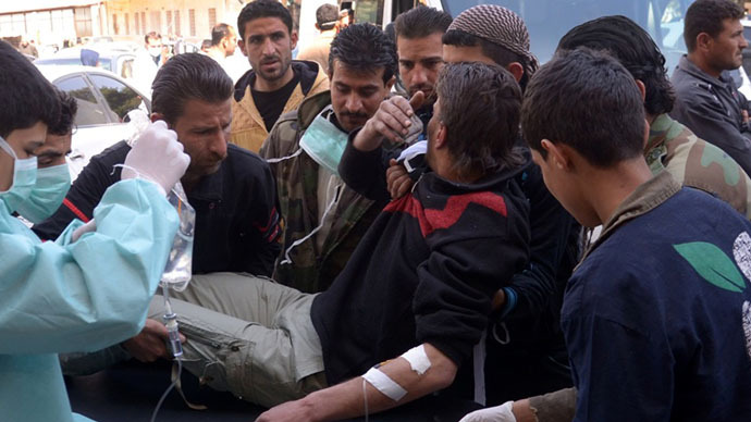 In this image made available by the Syrian News Agency (SANA) on March 19, 2013, a man is brought to a hospital in the Khan al-Assal region in the northern Aleppo province, as Syria's government accused rebel forces of using chemical weapons for the first time. (AFP Photo/SANA)