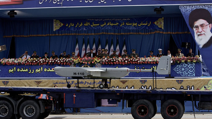 An Iranian made drone is driven past the platform where President Mahmoud Ahmadinejad and other military officials are sitting during the Army Day parade in Tehran on April 18, 2013.(AFP Photo / Behrouz Mehri)