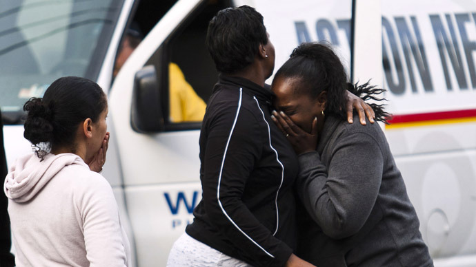People react during a hostage situation in Trenton, New Jersey, May 11, 2013. (Reuters)
