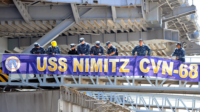US Navy crewmen display a banner on the nuclear powered aircraft carrier USS Nimitz at anchor in the southern port city of Busan on May 11, 2013.(AFP Photo / Jung Yeon-Je)