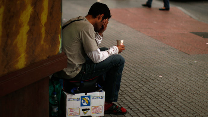 A man begs for money in downtown Malaga, southern Spain May 15, 2013. (Reuters / Jon Nazca)