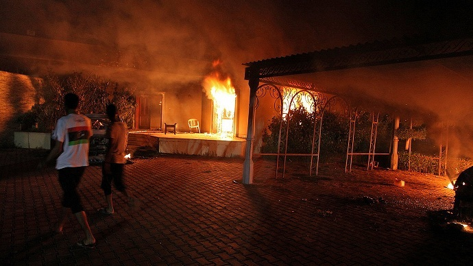 A vehicle and the surround buildings burn after they were set on fire inside the US consulate compound in Benghazi late on September 11, 2012 (AFP PHOTO)