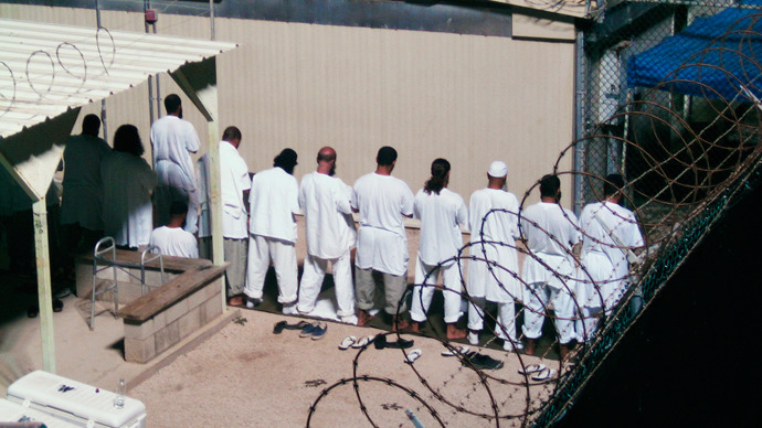 Detainees participate in an early morning prayer session at Camp IV at the detention facility in Guantanamo Bay U.S. Naval Base (Reuters)