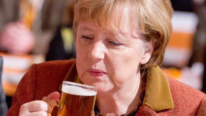German Chancellor Angela Merkel drinks a glass of beer at a festival in Munich, southern Germany (AFP Photo)