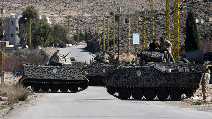 (FILE) Lebanese soldiers are deployed on a road at the entrance of the village of Arsal, on the border with Syria. (AFP Photo)