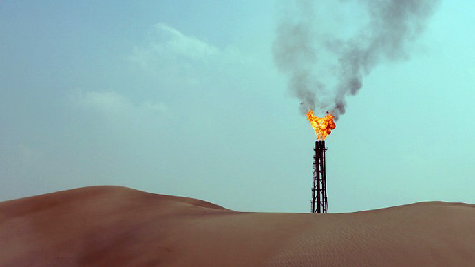 A general view shows burning flames from a gas well in Sailiya, 40km north of the Qatari capital Doha. (AFP Photo / Karim Sahib)