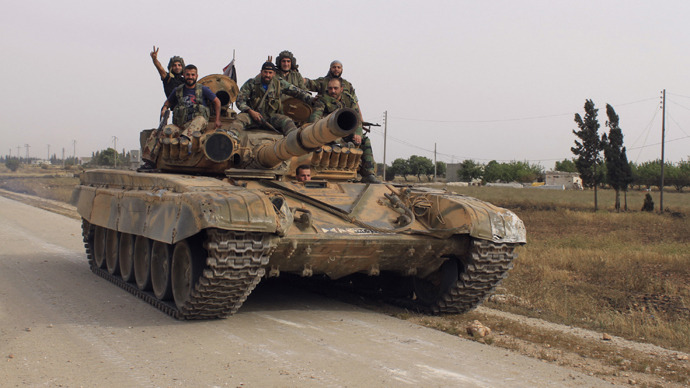 Forces of Syrian President Bashar al Assad are seen on a tank in Arjoun village near Qusair town May 30, 2013. (Reuters)