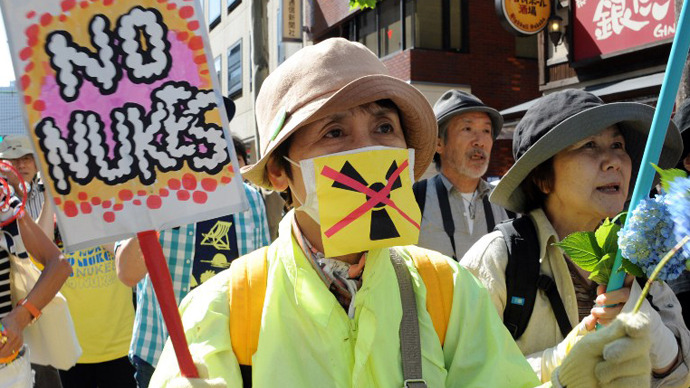 Protesters hold banners during a protest rally against nuclear power plants, following the March 2011 Fukushima meltdown-disasters, in Tokyo on June 2, 2013. (AFP Photo / Rie Ishii)