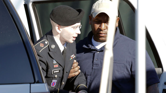 U.S. Army Private First Class Bradley Manning (L) arrives for day two of his court martial at Fort Meade, Maryland June 4, 2013.(Reuters / Gary Cameron)