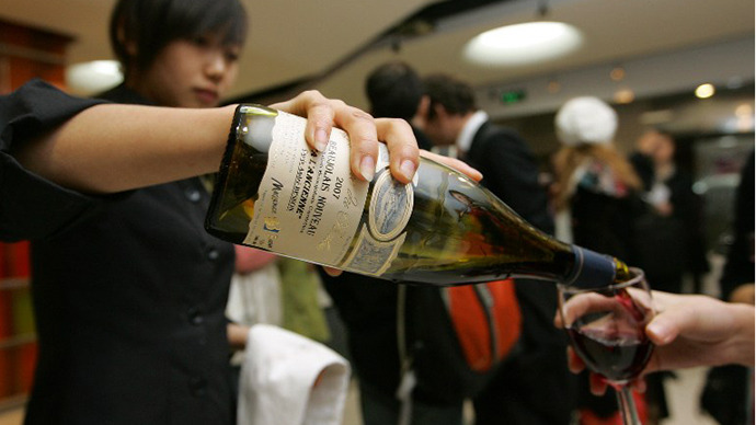 Wine is poured for guests at a launch party of the vintage Beaujolais Nouveau in Beijing. (AFP Photo / Frederic J. Brown)