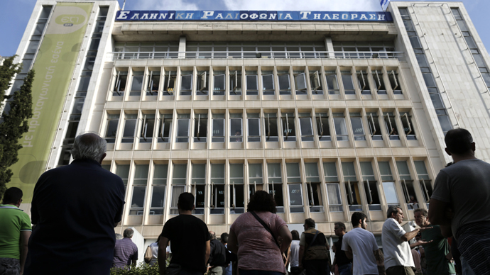 People stand in front of Greek state television ERT headquarters after the government's announcement that it will shut down the broadcaster in Athens June 11, 2013. (Reuters / John Kolesidis)