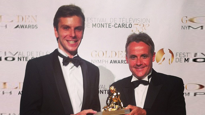 RT's anchor Bill Dod (right) and correspondent Egor Piskunov receive the Golden Nymph award for Best 24-hour News Program at the Monte Carlo Television Festival. Image from instagram.com @rt